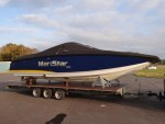 A Mastercraft boat loaded on the flat bed trailer for towing - click to enlarge