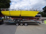 A lifting keel yacht being transported with its own unroadworthy trailer.